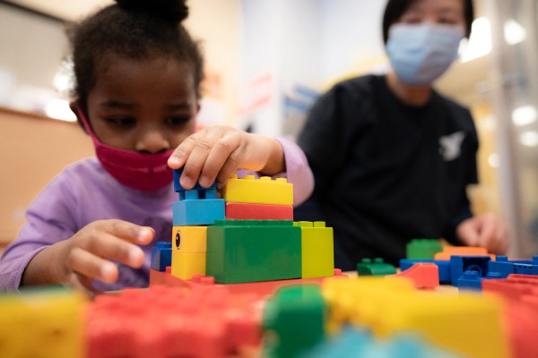 Children develop problem solving and planning skills when playing with building blocks.