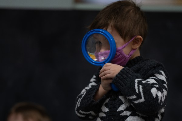 Child with a magnifying glass.